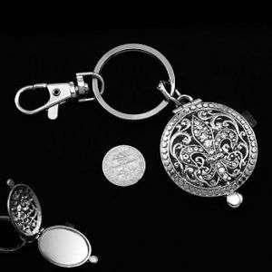Silver fleur de lis keychain and compact mirror