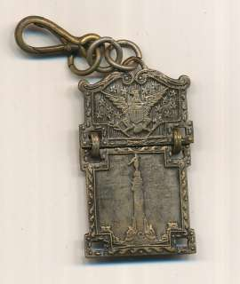 1893 CHICAGO WORLDS FAIR EXPOSITION SOUVENIR WATCH FOB. APROX 2 INCHES